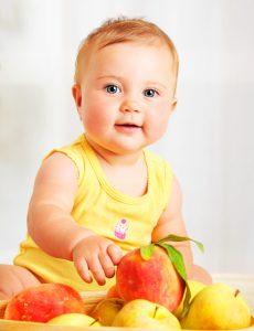 Baby girl choosing fruit